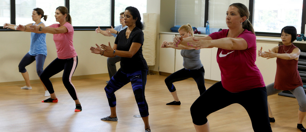 Dr. Anu Puttagunta, endocrinologist (2nd R), participates with hospital staff in a MOVE exercise class at Saint Joseph Mercy hospital in Ypsilanti, Michigan, U.S., August 23, 2017. Picture taken August 23, 2017.   REUTERS/Rebecca Cook - RC1B6027A800