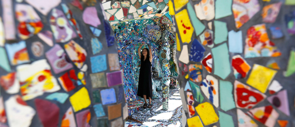 A visitor views the work of artists Gonzalo Duran and Cheri Pann at their Mosaic Tile House in Venice, California U.S., August 26, 2016.