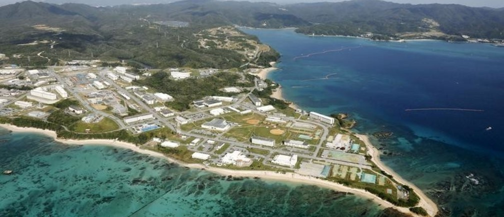 Coral reefs are seen along the coast near the U.S. Marine base Camp Schwab, off the tiny hamlet of Henoko in Nago, on the southern Japanese island of Okinawa, in this file aerial photo taken by Kyodo October 29, 2015 file photo.   Mandatory credit REUTERS/Kyodo/Files ATTENTION EDITORS - THIS IMAGE HAS BEEN SUPPLIED BY A THIRD PARTY. FOR EDITORIAL USE ONLY. NOT FOR SALE FOR MARKETING OR ADVERTISING CAMPAIGNS. MANDATORY CREDIT. JAPAN OUT. NO COMMERCIAL OR EDITORIAL SALES IN JAPAN.  - S1AETIHFMQAA