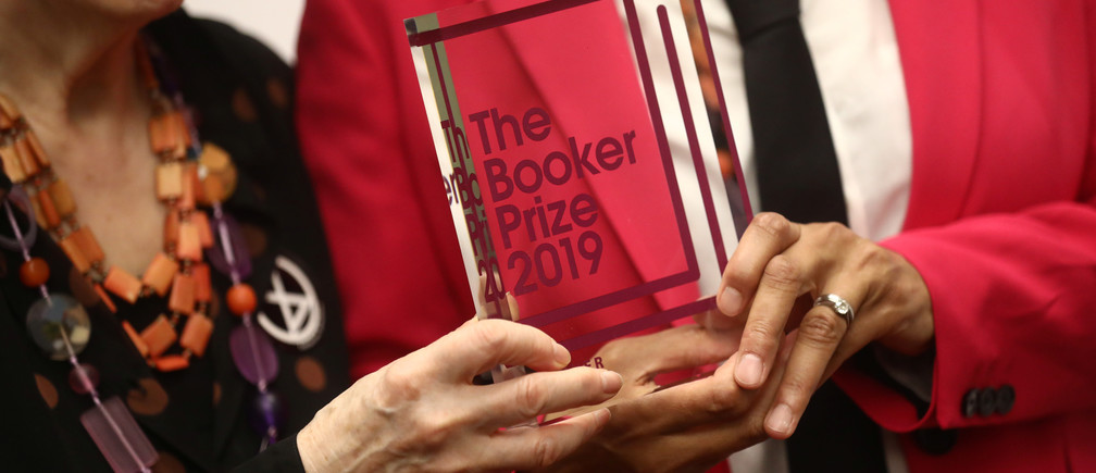 Margaret Atwood poses with Bernardine Evaristo with their Booker Prize for Fiction 2019 at the Guildhall in London, Britain October 14, 2019. REUTERS/Simon Dawson - RC1479BA1E80