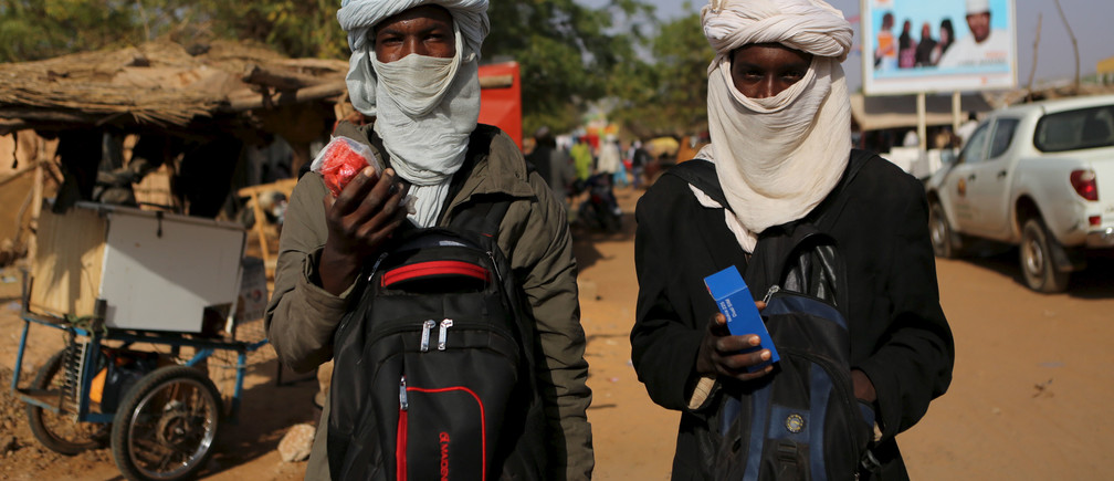 Two young Fulani men sell mobile phones in Niamey