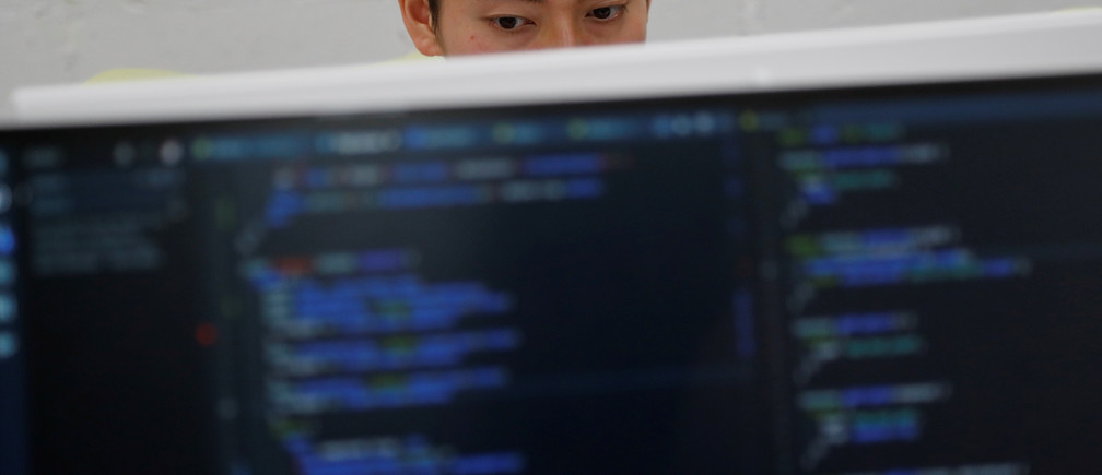 A student attends Code Chrysalis, a software-coding boot camp, at a basement room in Tokyo, Japan, May 23 2018. Picture taken May 23 2018. REUTERS/Toru Hanai - RC1B3E6A41C0
