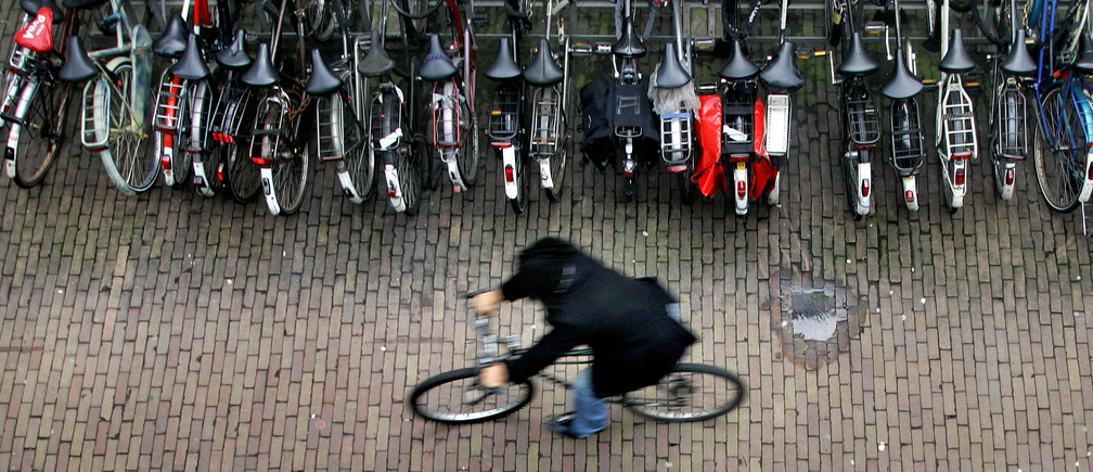 A man rides his bike in a bicycle shed near Central Station Amsterdam January 17, 2007.