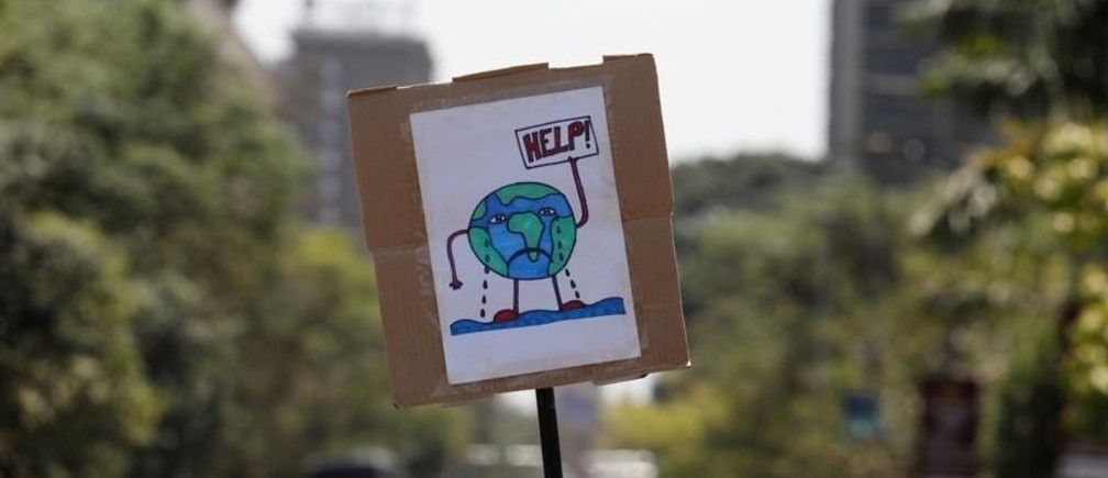 A sign carried by environmental activists is seen during the Climate strike protest calling for action on climate change, in Nairobi, Kenya, September 20, 2019. REUTERS/Baz Ratner - RC16E7BB4230