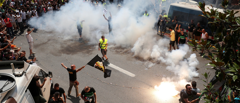 Taxi drivers hold a protest during a strike against what they say is unfair competition from ride-hailing and car-sharing services such as Uber and Cabify in Barcelona, July 2018.
