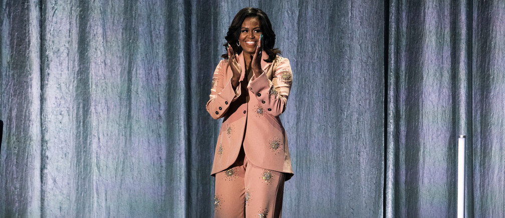 """Former first lady Michelle Obama claps on stage the Royal Arena during her book tour for her biography """"Becoming"""" in Copenhagen, Denmark April 9, 2019. Ritzau Scanpix/Martin Sylvest via REUTERS ATTENTION EDITORS - THIS IMAGE WAS PROVIDED BY A THIRD PARTY. DENMARK OUT. - RC177B53DE40"""
