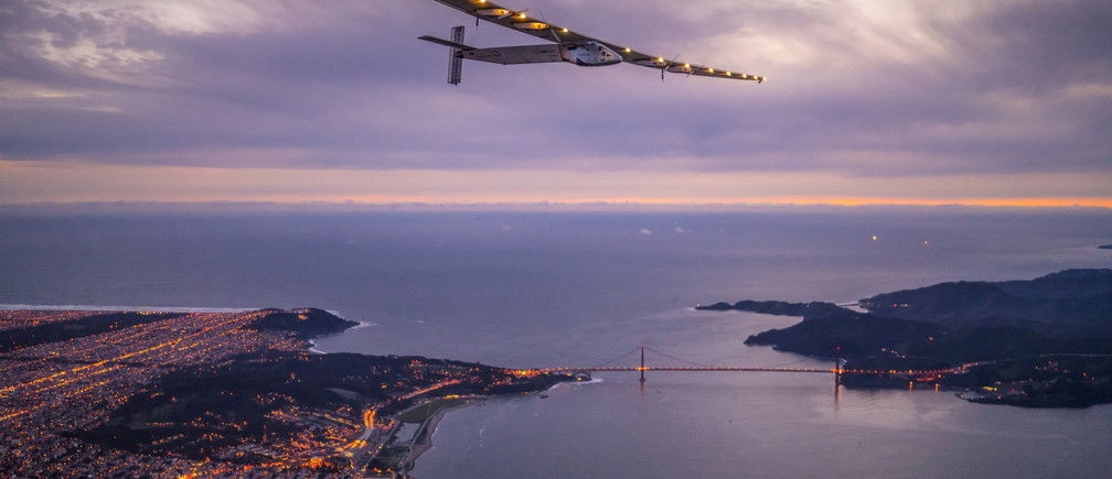 """Solar Impulse 2"", a solar-powered plane piloted by Bertrand Piccard of Switzerland, flies over the Golden Gate bridge in San Francisco, California, U.S. April 23, 2016, before landing on Moffett Airfield following a 62-hour flight from Hawaii.  Jean Revillard/Solar Impulse/Handout via REUTERS/File Photo   ATTENTION EDITORS - THIS IMAGE WAS PROVIDED BY A THIRD PARTY. EDITORIAL USE ONLY  - RTSJNRC"