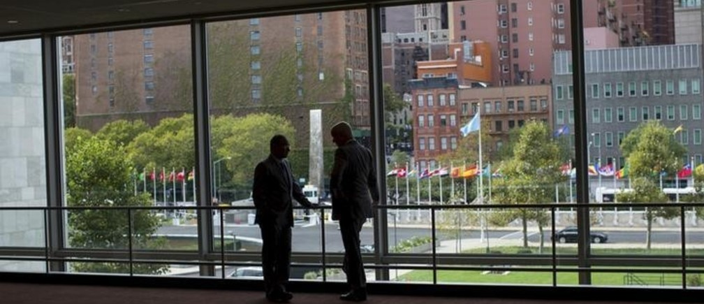 "Two diplomats talk in front of a window between the Secretariat and Assembly Buildings at the United Nations headquarters in New York City, September 21, 2015. As leaders from almost 200 nations gather for the annual general assembly at the United Nations, the world body created 70 years ago, Reuters photographer Mike Segar documented quieter moments at the famed 18-acre headquarters on Manhattan's East Side. The U.N., established as the successor to the failed League of Nations after World War Two to prevent a similar conflict from occurring again, attracts more than a million visitors every year to its iconic New York site. The marathon of speeches and meetings this year will address issues from the migrant crisis in Europe to climate change and the fight against terrorism. REUTERS/Mike SegarPICTURE 10 OF 30 FOR WIDER IMAGE STORY ""INSIDE THE UNITED NATIONS HEADQUARTERS""SEARCH ""INSIDE UN"" FOR ALL IMAGES"