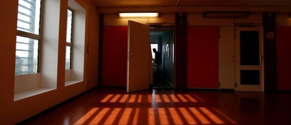 "An unidentified asylum seeker stands inside the former Bijlmerbajes prison, transformed into both ""The Movement Hotel"", staffed and run by asylum-seekers, and a center for asylum-seekers, in Amsterdam, Netherlands, September 20, 2017. Picture taken on September 20, 2017.  REUTERS/Cris Toala Olivares - RC1DA1F81F30"