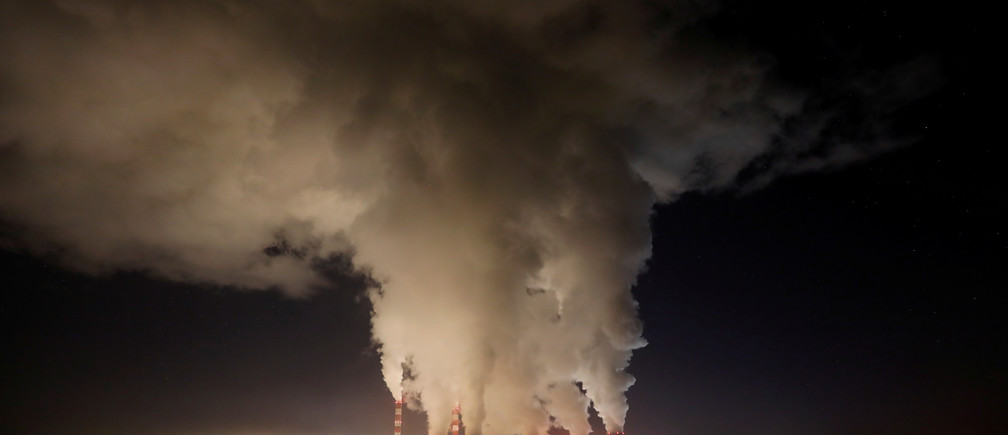 Smoke and steam billows from Belchatow Power Station, Europe's largest coal-fired power plant operated by PGE Group, at night near Belchatow, Poland December 5, 2018. Picture taken December 5, 2018.