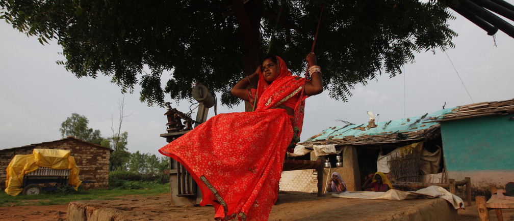 Child bride Krishna, 12, plays on an improvised swing outside her house in a village near Baran, located in the northwestern state of Rajasthan, July 30 , 2011. The legal age for marriage in India is 18, but marriages like these are common, especially in poor, rural areas where girls in particular are married off young. Some 47 percent of women aged between 20 and 24 years old were married before the age of 18, according to the government's latest National Family Health Survey. To match feature CHILDMARRIAGE/ REUTERS/Danish Siddiqui (INDIA - Tags: SOCIETY POLITICS) - RTR2PLPK