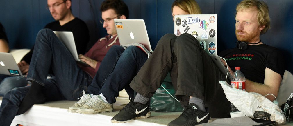 People use their computers during the 33th Chaos Communication congress, organized by the Chaos Computer Club, in Hamburg, Germany December 28, 2016.  REUTERS/Fabian Bimmer - RTX2WRDS