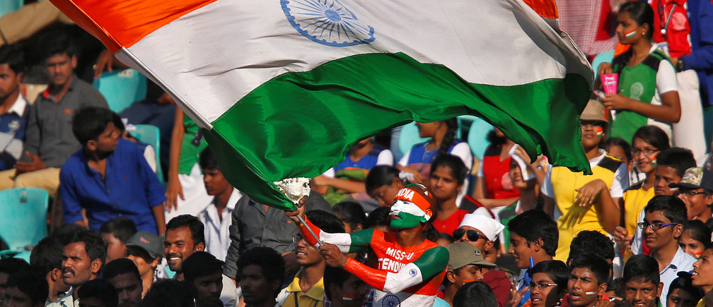 Cricket - India v England - Second Test cricket match - Dr. Y.S. Rajasekhara Reddy ACA-VDCA Cricket Stadium, Visakhapatnam, India - 19/11/16. A fan waves an Indian flag during the match. REUTERS/Danish Siddiqui - S1AEUNSMFKAB