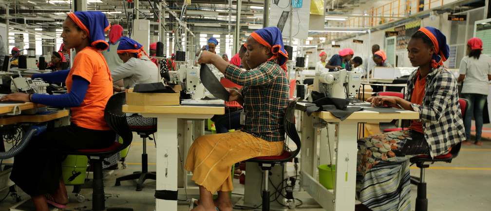 Workers sew clothes in Hawassa industrial park, one of five new facilities that have created 45,000 new jobs in Ethiopia.