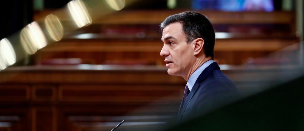 Spanish Prime Minister Pedro Sanchez speaks on coronavirus disease (COVID-19) at Parliament in Madrid, Spain, March 18, 2020. Mariscal/Pool via REUTERS - RC28MF9T08HH