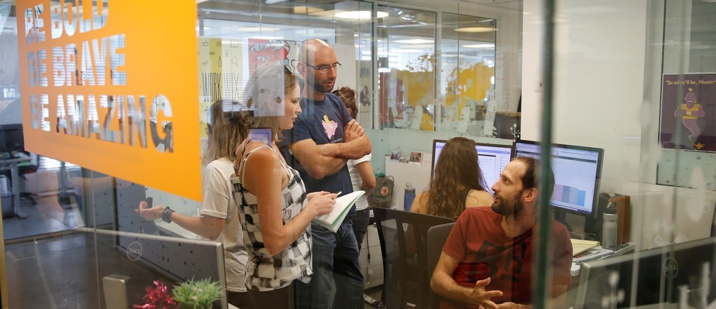 Employees work at website-designer firm Wix.com offices in Tel Aviv, Israel July 4, 2016.