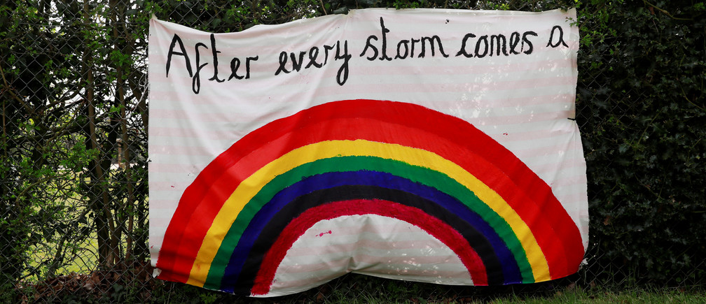 A rainbow banner is seen in Hertford as the spread of the coronavirus disease (COVID-19) continues, Hertford, Britain, April 3, 2020. REUTERS/Andrew Couldridge - RC21XF9JJ4JZ