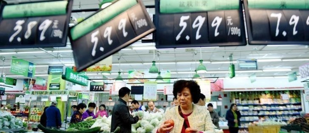 A woman shops at a supermarket in Hangzhou, Zhejiang province, China November 10, 2015. China's October inflation data showed persisting if not intensifying deflationary pressure, spurring analysts to expect more moves to stimulate the slowing economy by year-end.   REUTERS/China Daily CHINA OUT. NO COMMERCIAL OR EDITORIAL SALES IN CHINA      TPX IMAGES OF THE DAY