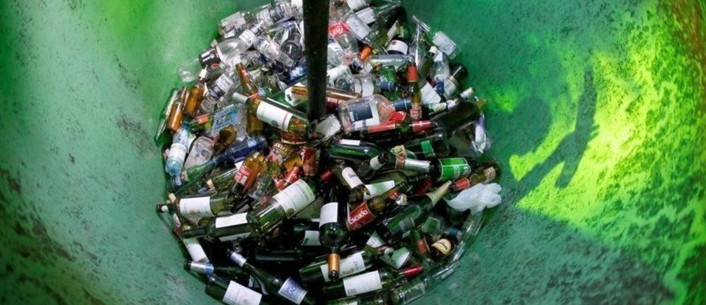 Glass bottles are seen inside a recycling container in Vina del Mar, Chile March 2, 2019. REUTERS/Rodrigo Garrido - RC1609E2A060