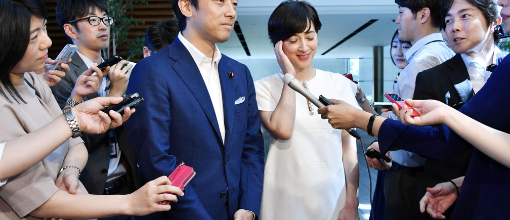 Shinjiro Koizumi, a Japanese lawmaker from the ruling Liberal Democratic Party and son of former prime minister Junichiro Koizumi, announces to media with television presenter Christel Takigawa on their marriage plans, at Prime Minister Shinzo Abe's official residence in Tokyo, Japan August 7, 2019, in this photo taken by Kyodo. Mandatory credit Kyodo via REUTERS ATTENTION EDITORS - THIS IMAGE WAS PROVIDED BY A THIRD PARTY. MANDATORY CREDIT. JAPAN OUT. NO COMMERCIAL OR EDITORIAL SALES IN JAPAN. - RC11FB3C2890
