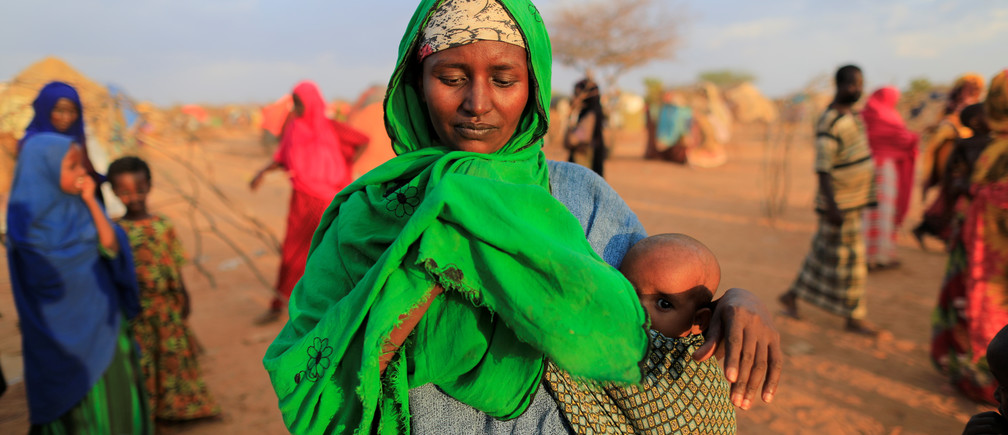 An internally displaced woman flees from drought in Dollow, Somalia.