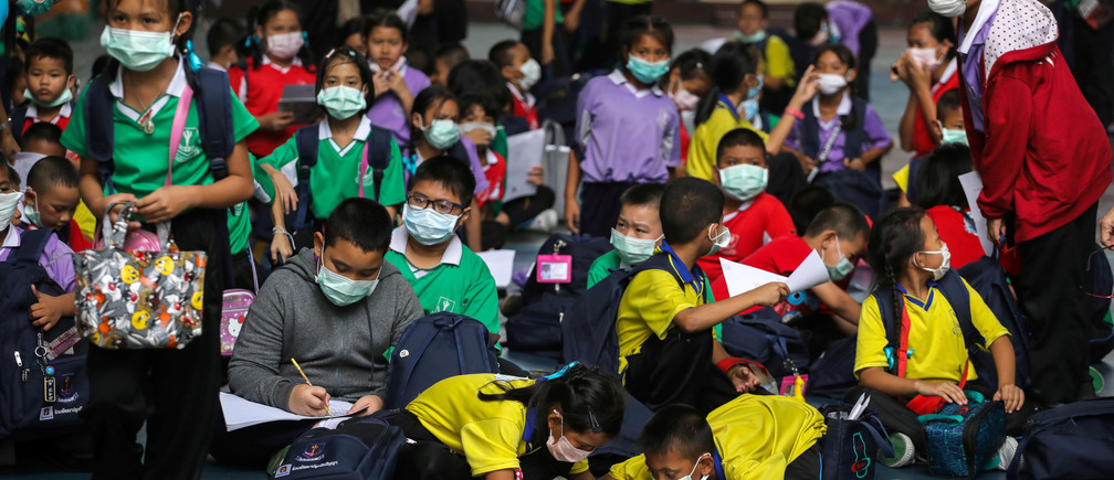Students wear masks as they wait to be picked up, as classes in over 400 Bangkok schools have been cancelled due to worsening air pollution, at a public school in Bangkok, Thailand, January 30, 2019.