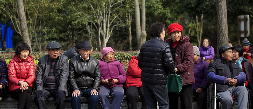 Elderly people enjoy the sunshine at an old residential site in Shanghai, China, March 14, 2016. REUTERS/Aly Song - GF10000344792