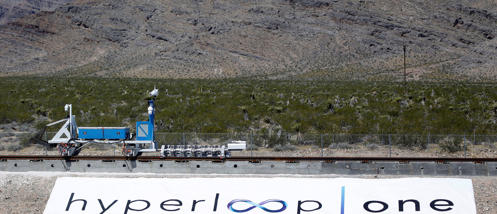 A sled recovery vehicle moves a test sled back to the starting position following a propulsion open-air test at Hyperloop One in North Las Vegas, Nevada, U.S. May 11, 2016. REUTERS/Steve Marcus - RTX2DWEO