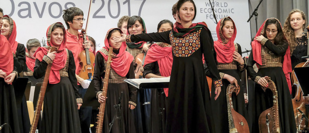 Negin Khpolwak, Conductor, Zohra Orchestra, Afghanistan National Institute of Music (ANIM), Afghanistan, Zarifa Adiba, Conductor, Zohra Orchestra, Afghanistan National Institute of Music (ANIM), Afghanistan, Ahmad Sarmast, Founder, Afghanistan National Institute of Music (ANIM), Afghanistan, at the Annual Meeting 2017 of the World Economic Forum in Davos, January 19, 2017 Copyright by World Economic Forum / Walter Duerst