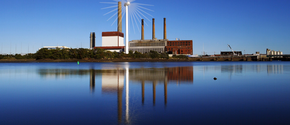 A Massachusetts Water Resources Authority wind turbine turns in front of a 1951 megawatt fossil fuel power plant in Charlestown, Massachusetts September 18, 2013.   The wind turbine powers the MWRA waste water pumping station at that site and the power plant uses natural gas and oil.  The Intergovernmental Panel on Climate Change conference will be held in Stockholm September 23 to 26. This is an in-camera, multiple exposure photograph.  REUTERS/Brian Snyder  (UNITED STATES - Tags: ENVIRONMENT ENERGY) - GM1E99J0JII01
