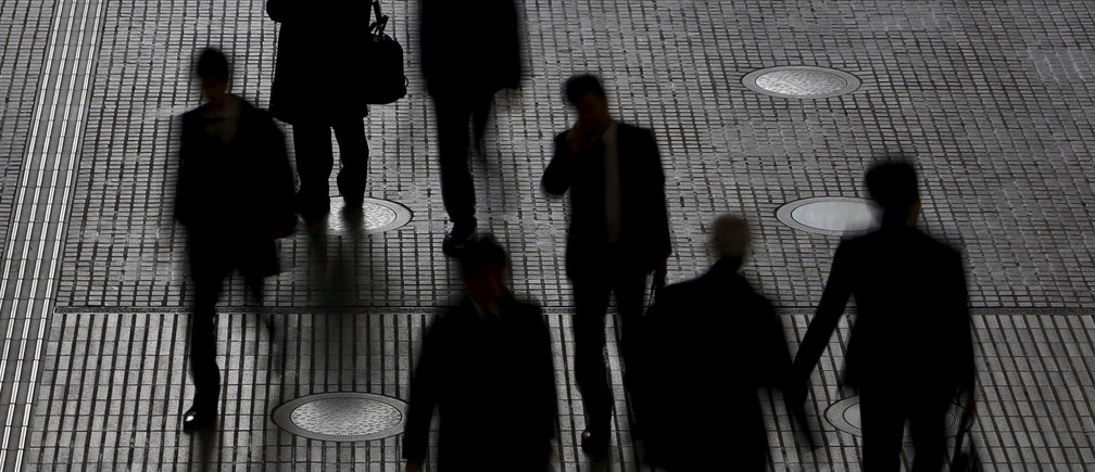 People walk at an office building at a business district in Tokyo, Japan, February 29, 2016. Japan's seasonally adjusted unemployment rate fell in January to 3.2 percent, data by the Ministry of Internal Affairs and Communications showed on Tuesday. Picture taken February 29, 2016. REUTERS/Yuya Shino      TPX IMAGES OF THE DAY      - GF10000328221