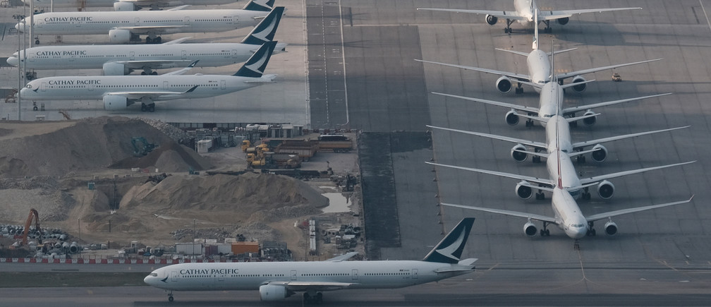 Cathay Pacific aircraft are seen parked on the tarmac at the airport, following the outbreak of the new coronavirus, in Hong Kong, China March 5, 2020. REUTERS/Tyrone Siu - RC2LDF9WBMWC