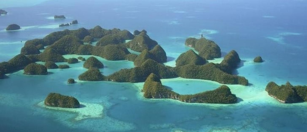 An aerial view of islands in Palau in this undated photo. Palau, a nation of sparsely populated Pacific islands surrounded by turquoise waters teeming with fish and giant clams, is so obscure most people must scour a map to find it. But with a crop of high-end resorts coming up, the islands may soon become a luxury tourist hotspot. To match Reuters Life! PALAU-TRAVEL/  REUTERS/Jackson Henry  (PALAU SOCIETY TRAVEL) FOR EDITORIAL USE ONLY. NOT FOR SALE FOR MARKETING OR ADVERTISING CAMPAIGNS