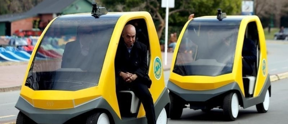 Horacio Rodriguez Larreta, current cabinet chief of Buenos Aires' City government and Mayor-elect, descends form a prototype autonomous electric vehicle during its presentation in Buenos Aires, August 19, 2015. The autonomous vehicle, the first of its kind developed in Argentina, is able to fulfill the main functions of mobility of a traditional car but autonomously through the use of artificial intelligence that enables it to detect their surroundings and move without human intervention