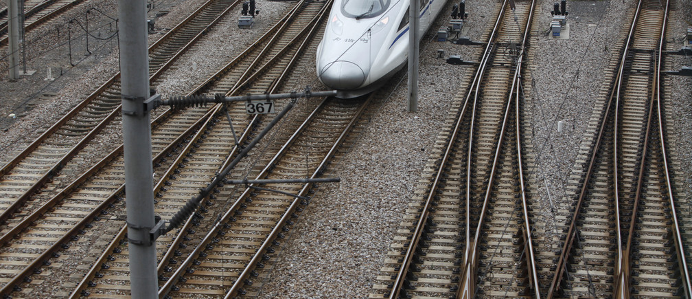 A China Railway High-speed (CRH) Harmony bullet train pulls into Shanghai Railway Station May 23, 2012. China will fast track approvals for infrastructure investment to combat a slowdown in the economy, a state-backed newspaper reported on Tuesday, showing how Premier Wen Jiabao's call for policies to support growth is being put into action. REUTERS/Aly Song (CHINA - Tags: BUSINESS TRANSPORT POLITICS) - GM1E85N188J01