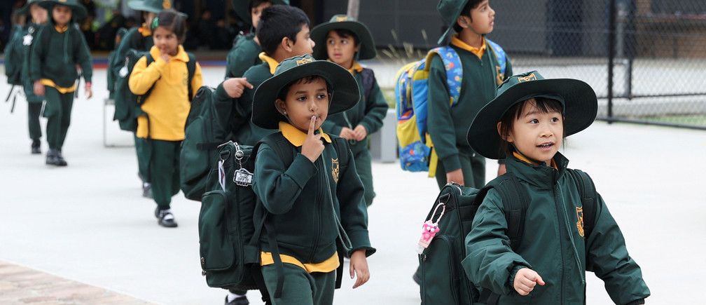 Children return to campus for the first day of New South Wales public schools fully re-opening for all students and staff amidst the easing of the coronavirus disease (COVID-19) restrictions at Homebush West Public School in Sydney, Australia, May 25, 2020.  REUTERS/Loren Elliott - RC2CVG9TY5LS