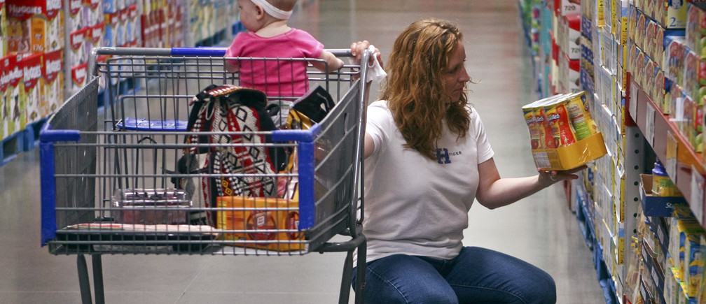 "A customer shops in the expanded baby department at a remodelled Sam's Club in Rogers, Arkansas June 3, 2010. Sam's Club executives have a new way to boost sales: the warehouse club unit of Wal-Mart is adding 24 imported cheeses to its product assortment, just one of the many steps it is taking in a massive three-year remodeling project called ""Project Portfolio"". Shoppers will also see more fresh product and meat, health and beauty items and baby-care products with the remodels.               REUTERS/Sarah Conard (UNITED STATES - Tags: BUSINESS) - GM1E6640HFW01"