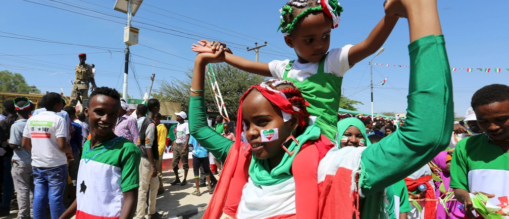A girl sporting a sticker on her face with the colours of the national flag participates in a street parade to celebrate the 24th self-declared independence day for the breakaway Somaliland nation from Somalia in capital Hargeysa, May 18, 2015.