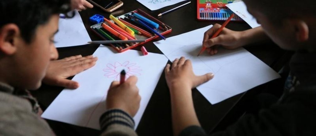 Yazidi students draw at the psychotherapy centre in the Rawanga camp, in Duhok, Iraq February 25, 2018. Picture taken February 25, 2018.