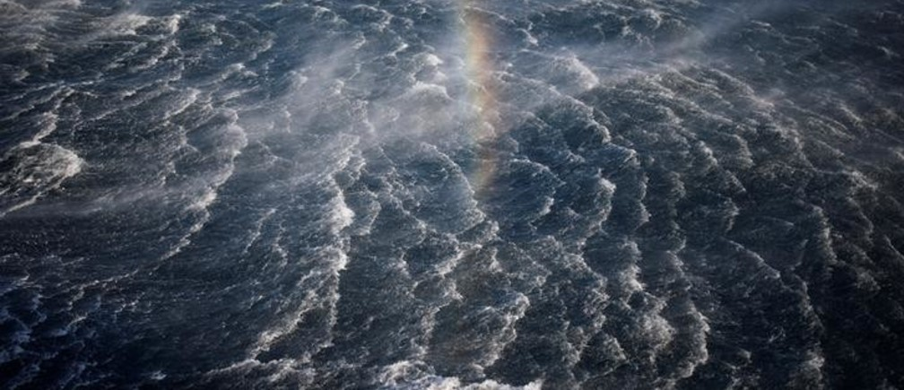 A rainbow is seen during a combined drill of the Israeli navy and a helicopter squadron, practicing the evacuation of a wounded person to land from a vessel in the Mediterranean Sea, off the coast of Ashdod, southern Israel September 19, 2016. Picture taken September 19, 2016. REUTERS/Amir Cohen