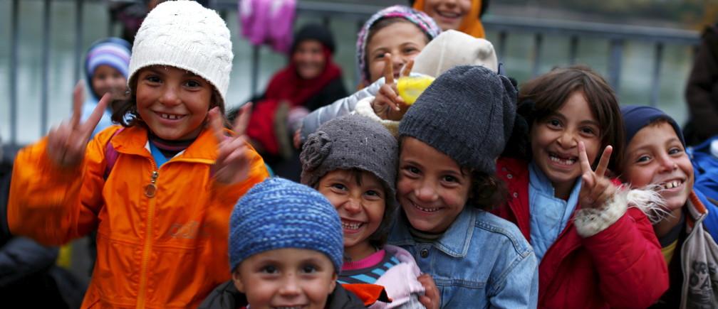 Migrant children pose before passing the Austrian-German border.