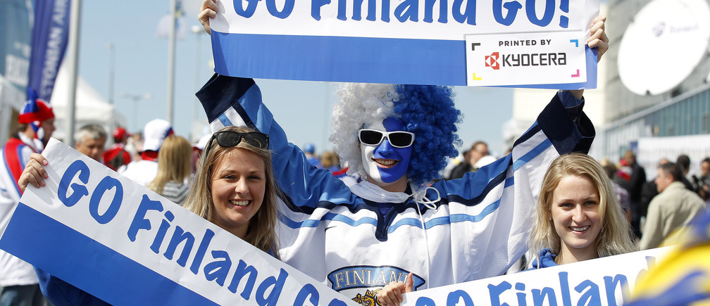 Supporters of Finland hold posters before the start of their 2012 IIHF men's ice hockey World Championship semi-final game against Russia in Helsinki May 19, 2012.    REUTERS/Petr Josek (FINLAND  - Tags: SPORT ICE HOCKEY)   - LR2E85J0WB4C1