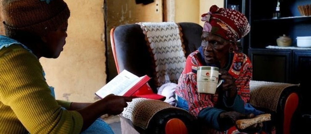 "Fikhile Mthiyane reads the bible with her mother-in-law Thumekile Mthiyane, 90, who is known as Gogo Mthiyane, at their family home in KwaNdengezi, South Africa, May 18, 2017. Gogo means grandmother in Zulu. REUTERS/Rogan Ward  SEARCH ""WARD GENERATIONS"" FOR THIS STORY. SEARCH ""WIDER IMAGE"" FOR ALL STORIES."