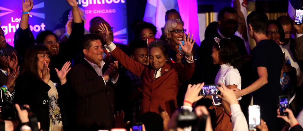 Mayoral candidate Lori Lightfoot (C) celebrates her election night victory after defeating her challenger Toni Preckwinkle in a runoff election in Chicago, Illinois, U.S., April 2, 2019.  REUTERS/Joshua Lott - RC1F27C79120