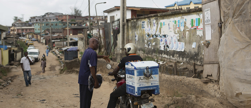 A Jumia courier makes a delivery by motorcycle in Lagos, Nigeria.