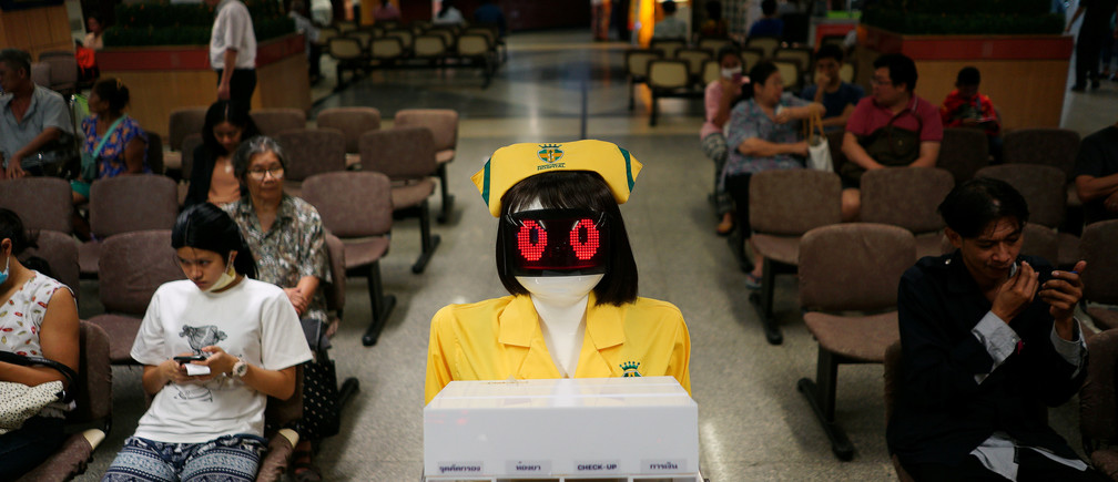 A robot wearing a nurse costume carries medical documents at Mongkutwattana General Hospital in Bangkok, Thailand, February 6, 2019. REUTERS/Athit Perawongmetha - RC1B01E87750