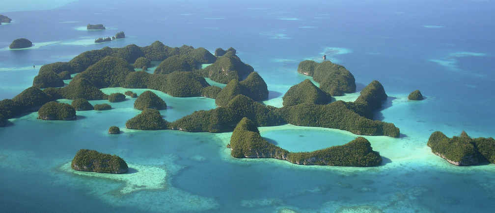 An aerial view of islands in Palau in this undated photo. Palau, a nation of sparsely populated Pacific islands surrounded by turquoise waters teeming with fish and giant clams, is so obscure most people must scour a map to find it. But with a crop of high-end resorts coming up, the islands may soon become a luxury tourist hotspot. To match Reuters Life! PALAU-TRAVEL/  REUTERS/Jackson Henry  (PALAU SOCIETY TRAVEL) FOR EDITORIAL USE ONLY. NOT FOR SALE FOR MARKETING OR ADVERTISING CAMPAIGNS - GM1E5A212EK01