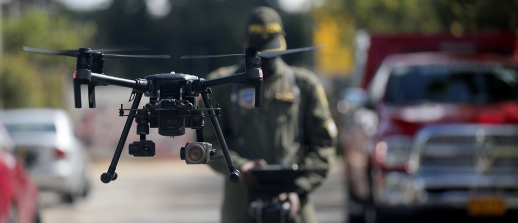 A Colombian police officer operates a drone that measures body temperature, in an area of high contagion amid the coronavirus disease (COVID-19) outbreak, in Bogota, Colombia May 20, 2020.