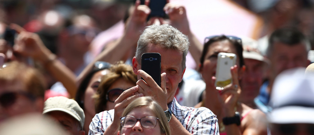 People take pictures with their cell phones in Saint Peter's Square at the Vatican, July 2, 2017.    REUTERS/Alessandro Bianchi - RC1889631EB0