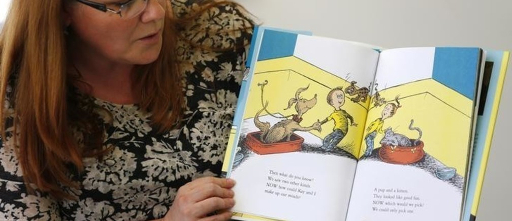 """Reference librarian Marlayna Christensen reads to children Dr. Seuss' new book """"What Pet Should I Get?"""" at the University of California San Diego's Geisel Library in San Diego, California July 28, 2015. The story is based on materials found two years ago in a box at the La Jolla home of Audrey Geisel, the widow of Theodor """"Dr. Seuss"""" Geisel, who wrote the children's classics """"The Cat in the Hat"""" and """"Green Eggs and Ham"""". REUTERS/Mike Blake"""